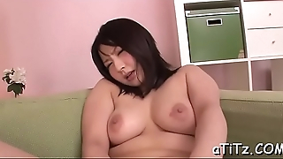 Asian strokes her own boobs previous to giving hot blowjob