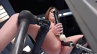 Natural busty brunette gets orgasm on machine