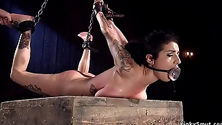 Brunette with natural big tits in bdsm